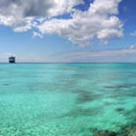Precipitation and clouds produced by healthy coral reefs